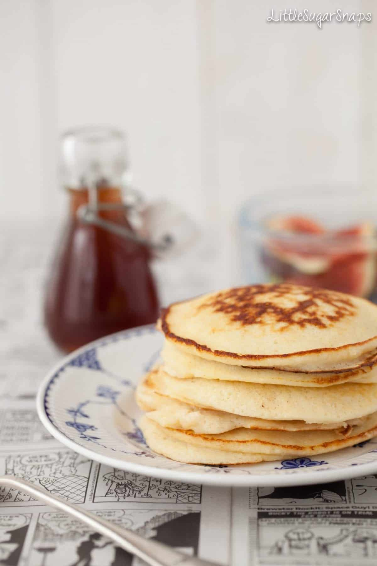 Ricotta hotcakes in a stack with syrup and figs ready to put on
