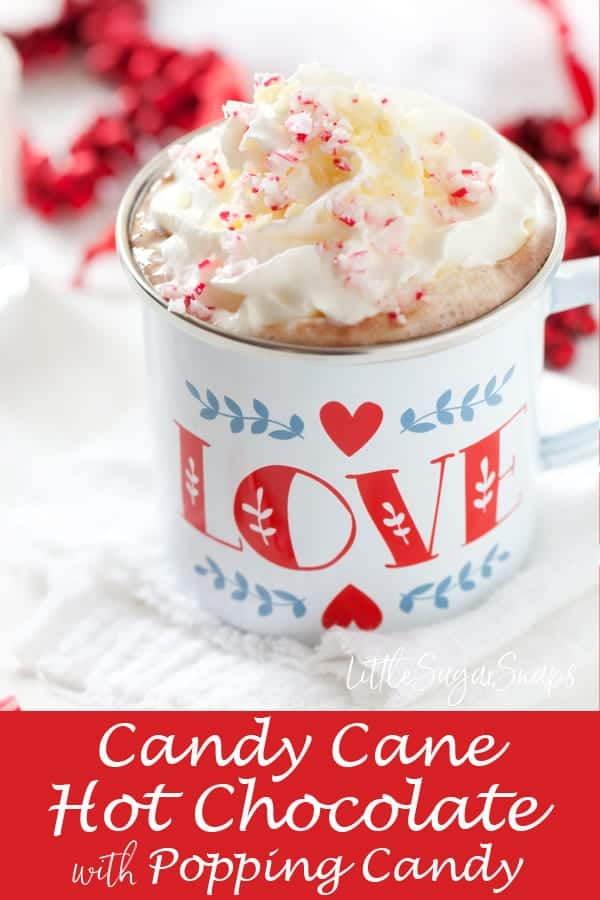 Candy Cane Hot Chocolat: flavoured with peppermint candy canes. Topped with cream, candy cane pieces & popping candy. Immense fun for a cosy festive treat. #candycanehotchocolate #pepperminthotchocolate #candycane ##poppingcandy #poppingcandyhotchocolate #candycanedrink #poppingcandydrink