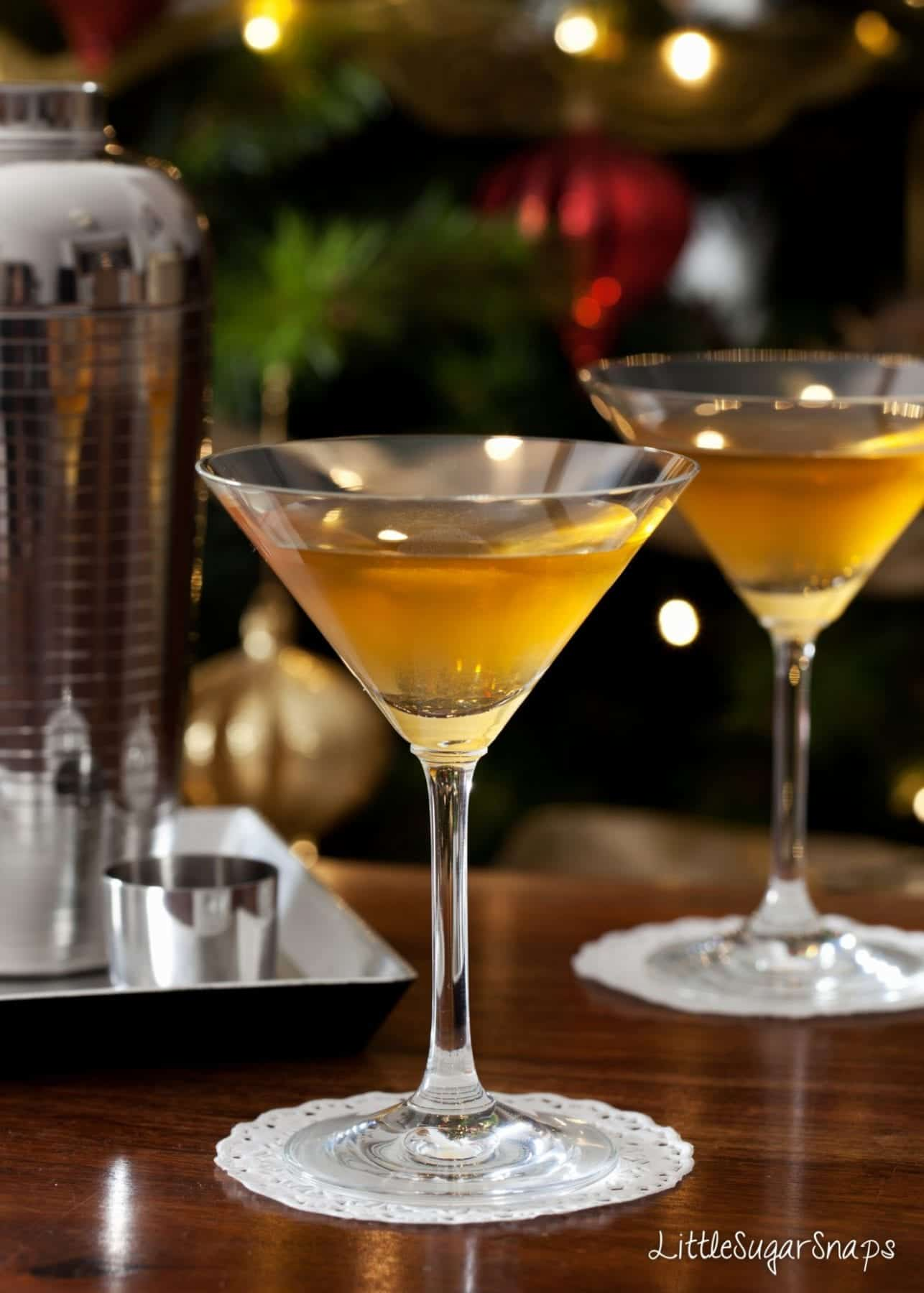 Amaretto cocktails served in martini glasses on a wooden table