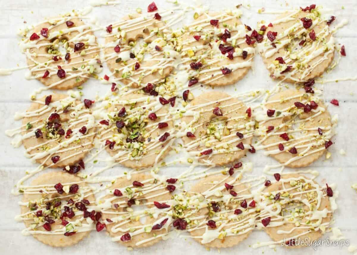 Sheet of Christmas wreath cookies with white chocolate, pistachios and cranberries