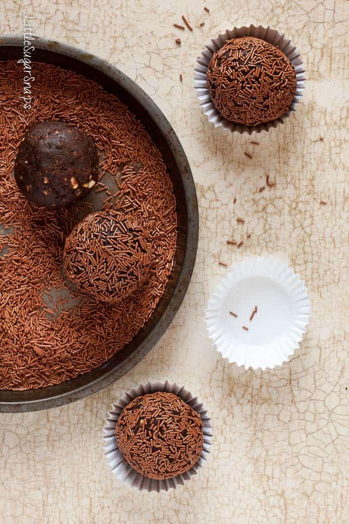 Chocolate nut truffle balls being rolled in vermicilli strands