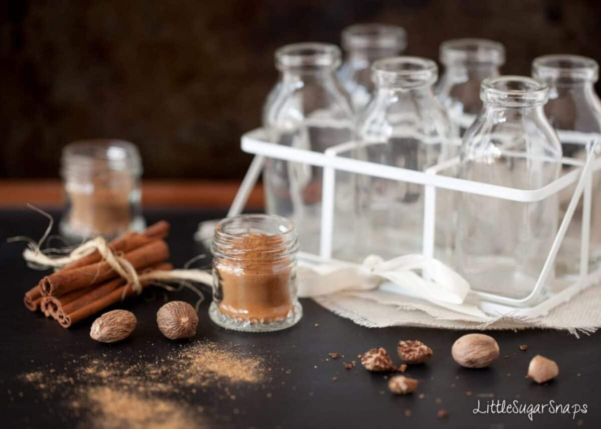 cinnamon & nutmeg and small glass milk bottles