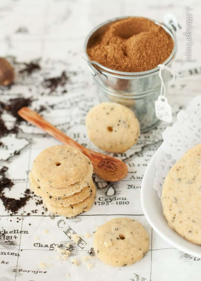 A stack of mini chai spiced cookies with flecks of black tea in them.