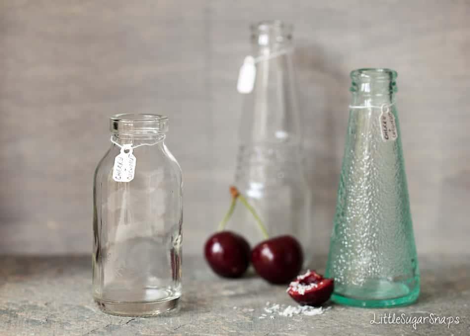 Three small empty bottles on a kitchen countertop