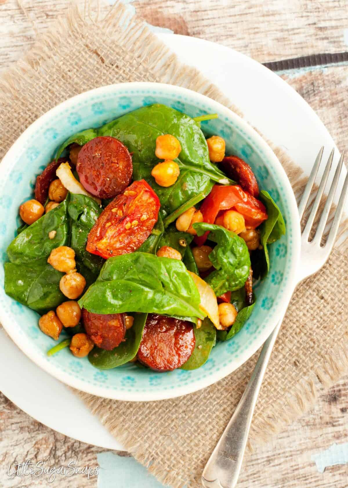 Roasted chickpea salad with spinach, tomato and chorizo