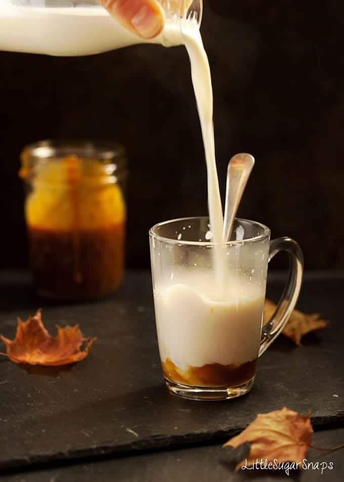 Bourbon Caramel milk drink being poured into a glass mug