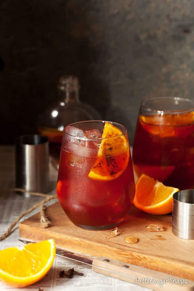 Negroni cocktails garnished with charred orange wedges
