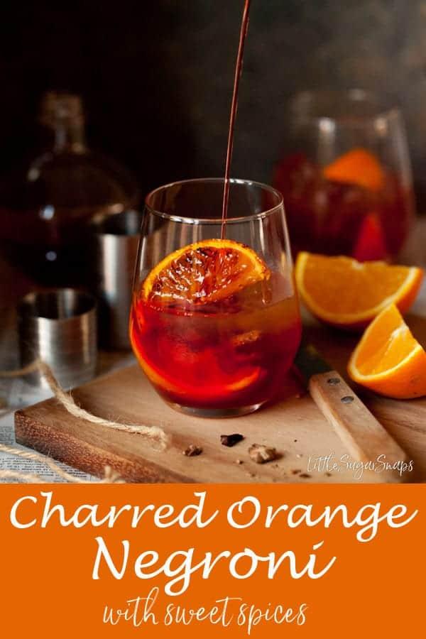 Winter Spice Negroni #negroni #spicedgin #orangenegroni #cinnamonnegroni #camparidrink #wintercocktasil #winterdrink #charredorange #gin #campari