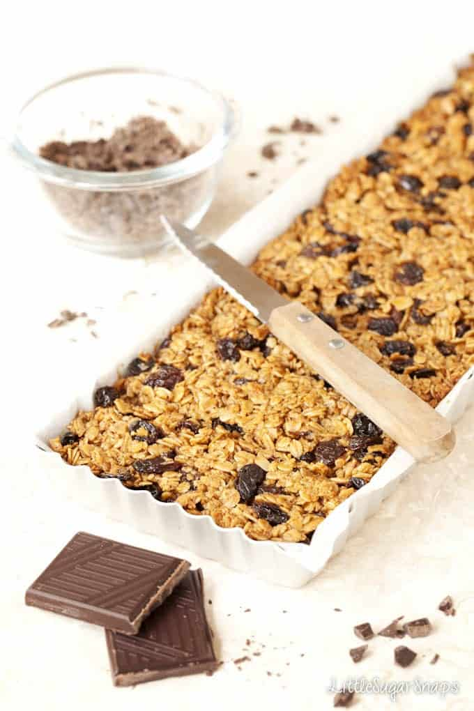 Flapjack with raisins in a baking tin baked and ready to cut