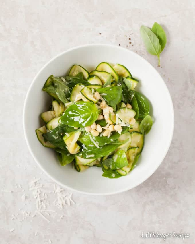 A bowl of Zucchini & Basil Salad with parmesan and pine nuts