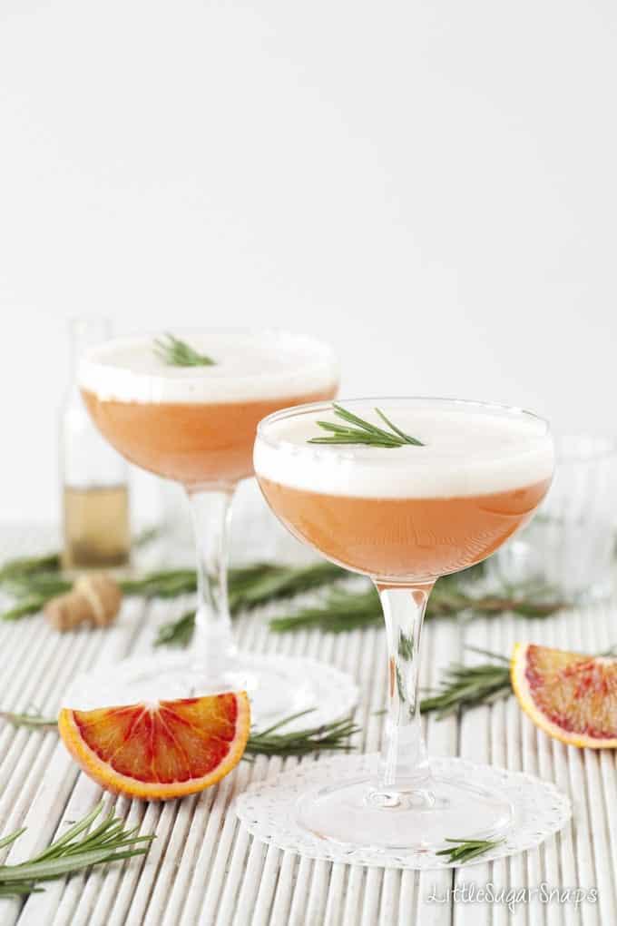 Two glasses of Blood Orange Martini with egg white foam