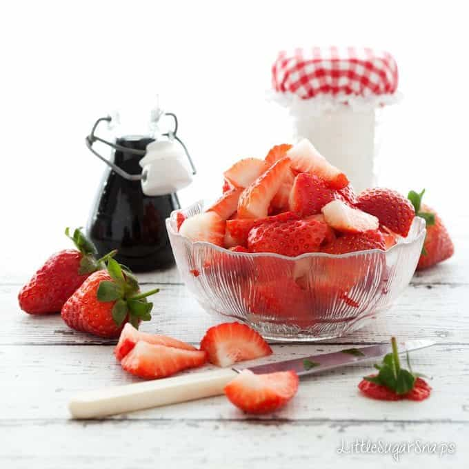 Fresh strawberries in a vintage glass bowl
