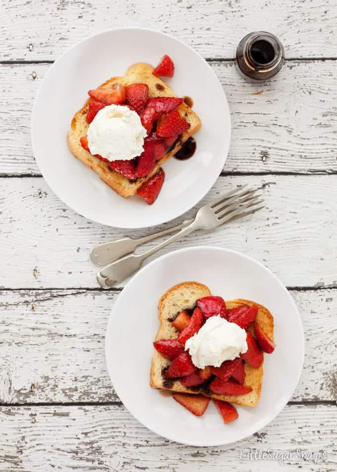 Plates of brioche toast with strawberries, balsamic syrup and mascarpone