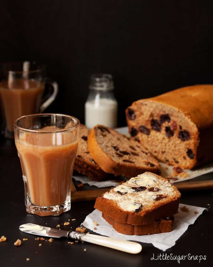 Buttered Slices of cherry Tea Bread cut served with tea
