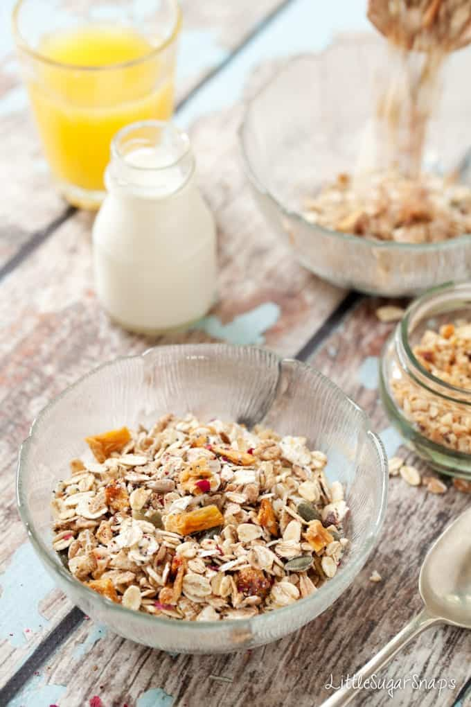 A bowl of homemade Muesli with a small bottle of milk