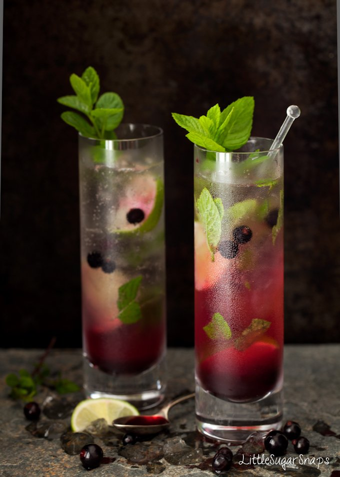 Blackcurrant Mojitos in tall slim glasses