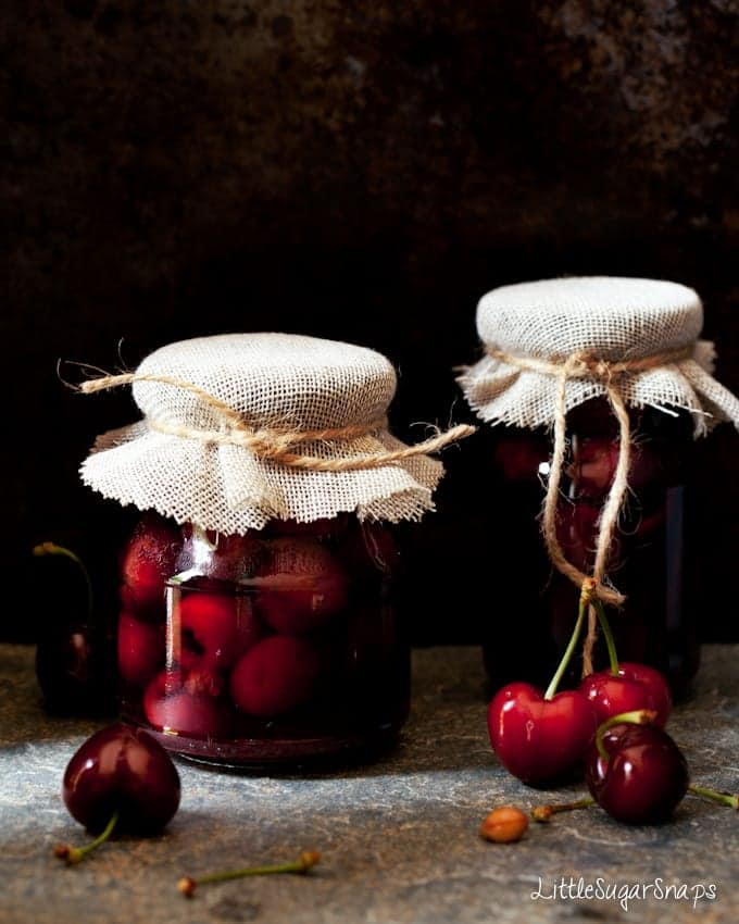 spiced bourbon cherries in jars sealed with string and hessian
