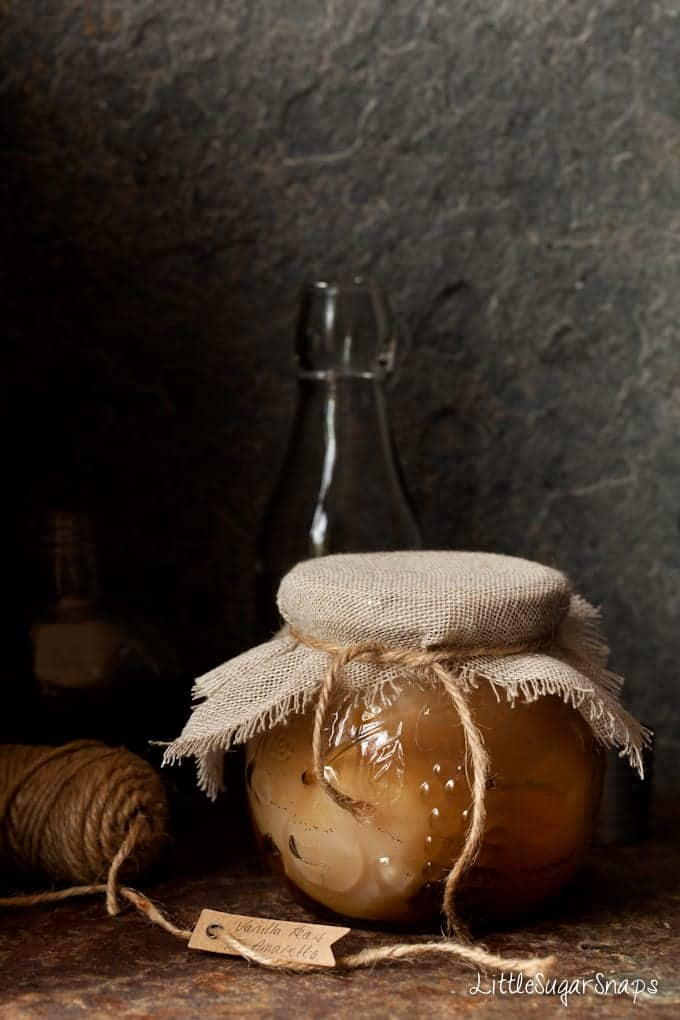Sealed gift jar of fruit in a liqueur syrup with string and a lable