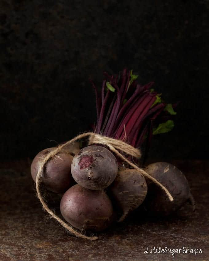 A bundle of raw beetroot tied with string.