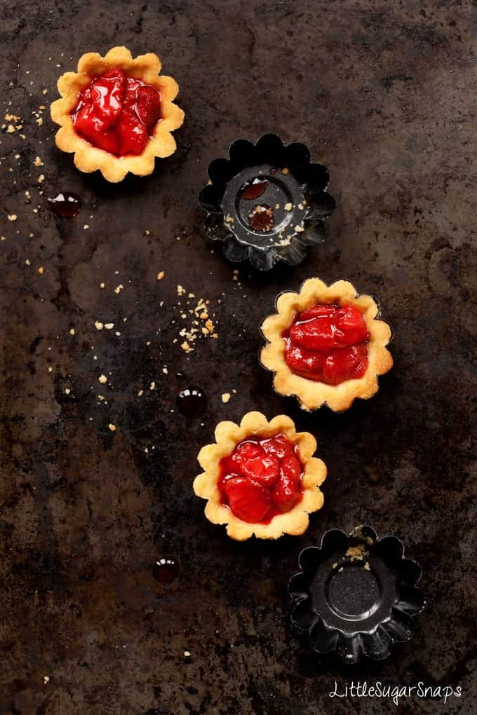 Mini Strawberry tarts and small baking tins