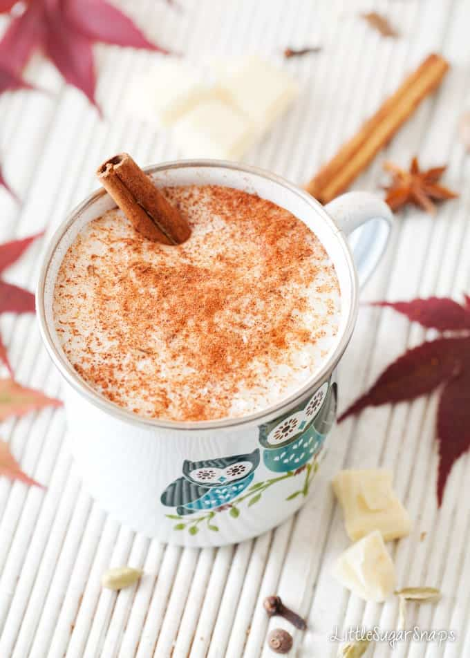 White Hot Chocolate in an enamel mug topped with ground spice