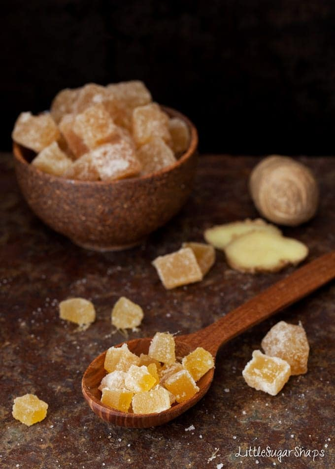 Crystalised ginger on a wooden spoon