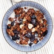 Healthy Chocolate Granola Recipe - a portion in a bowl with milk poured over it