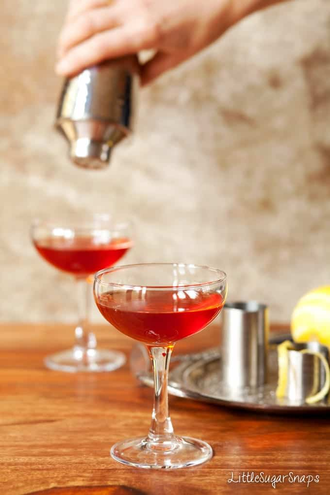 Bourbon, Campari & Amaro Cocktail being poured