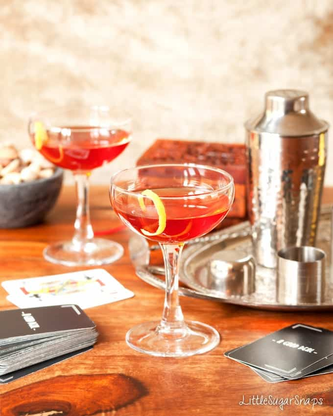 Bourbon Campari Amaro Cocktail (The Italian American) with playing cards