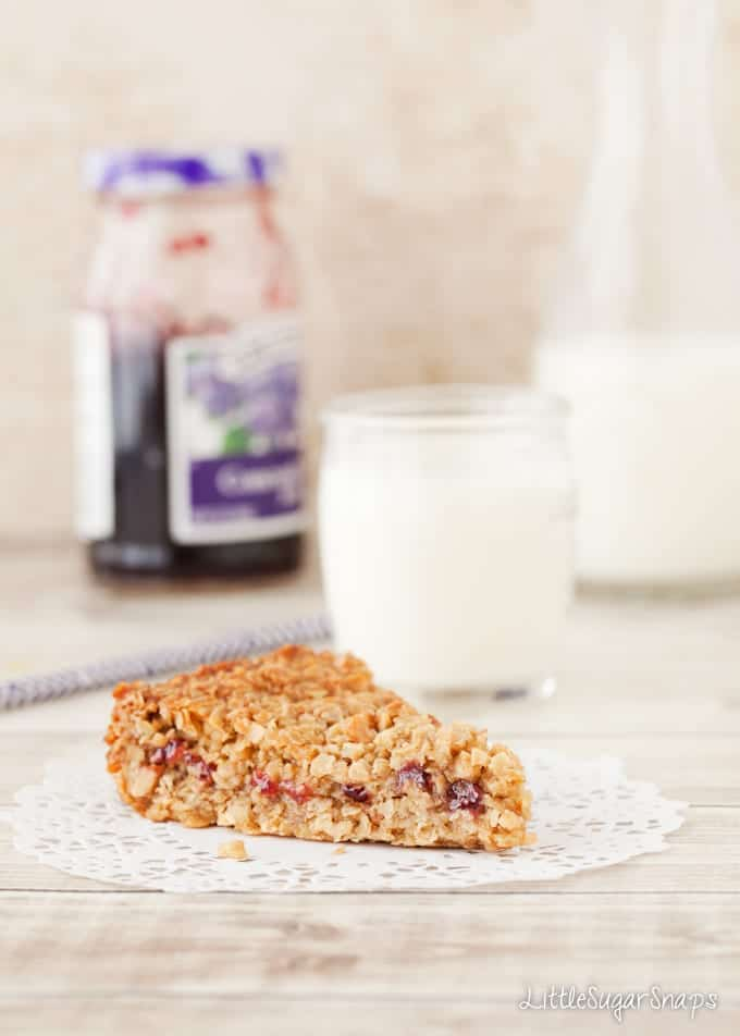 Peanut Butter Flapjack with jam in the middle and a jam-jar behind