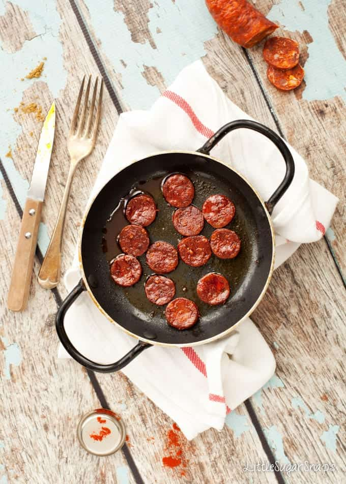 Pieces of cooked chorizo in a small skillet