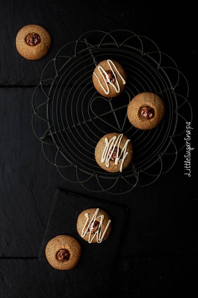 Flatlay of Nutella thumbprint cookies arranged artistically on a wire rack