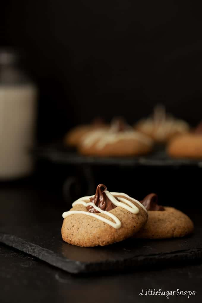 Nutella thumbprint cookies drizzled with white chocolate