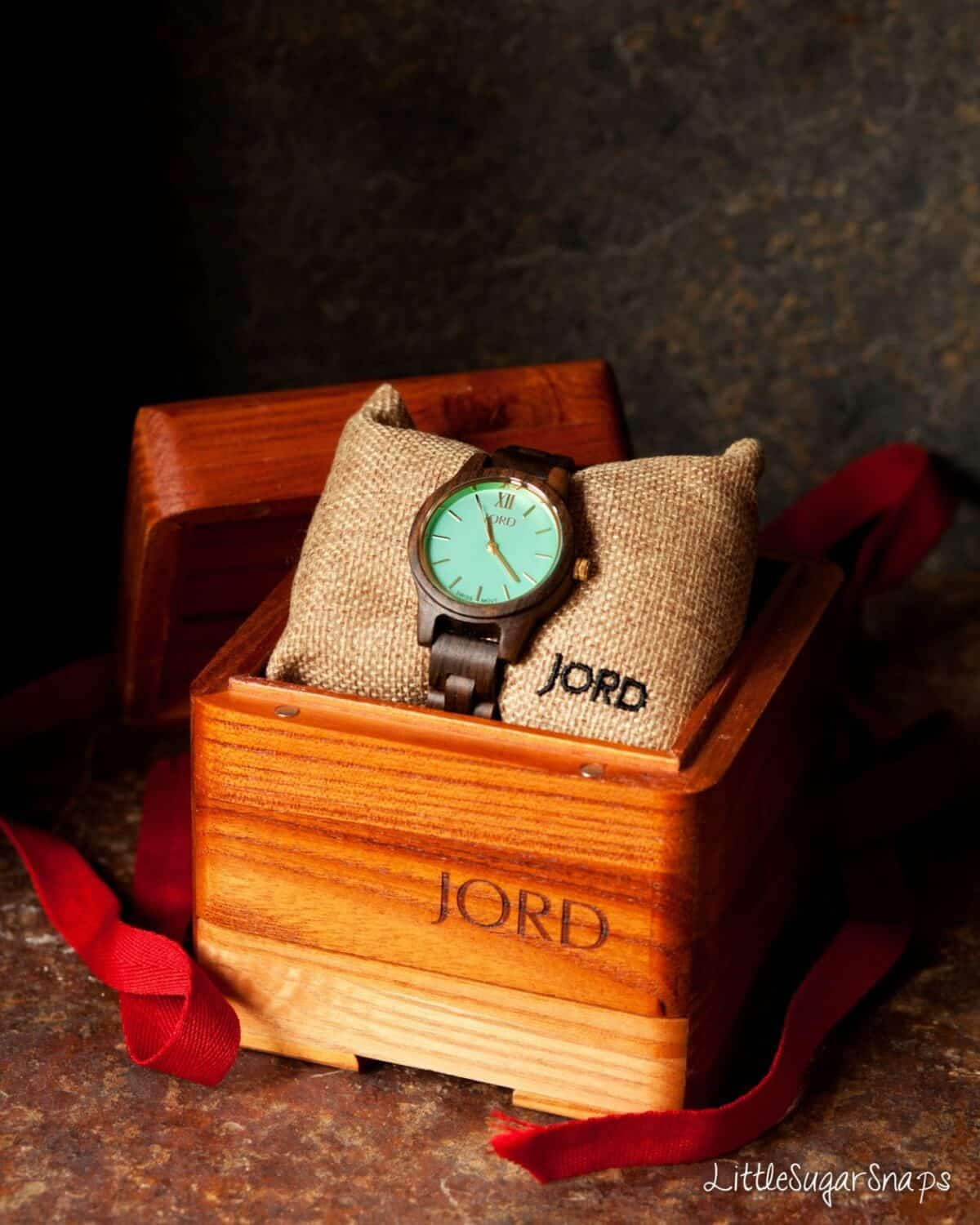 A wooden watch in a presentation box.