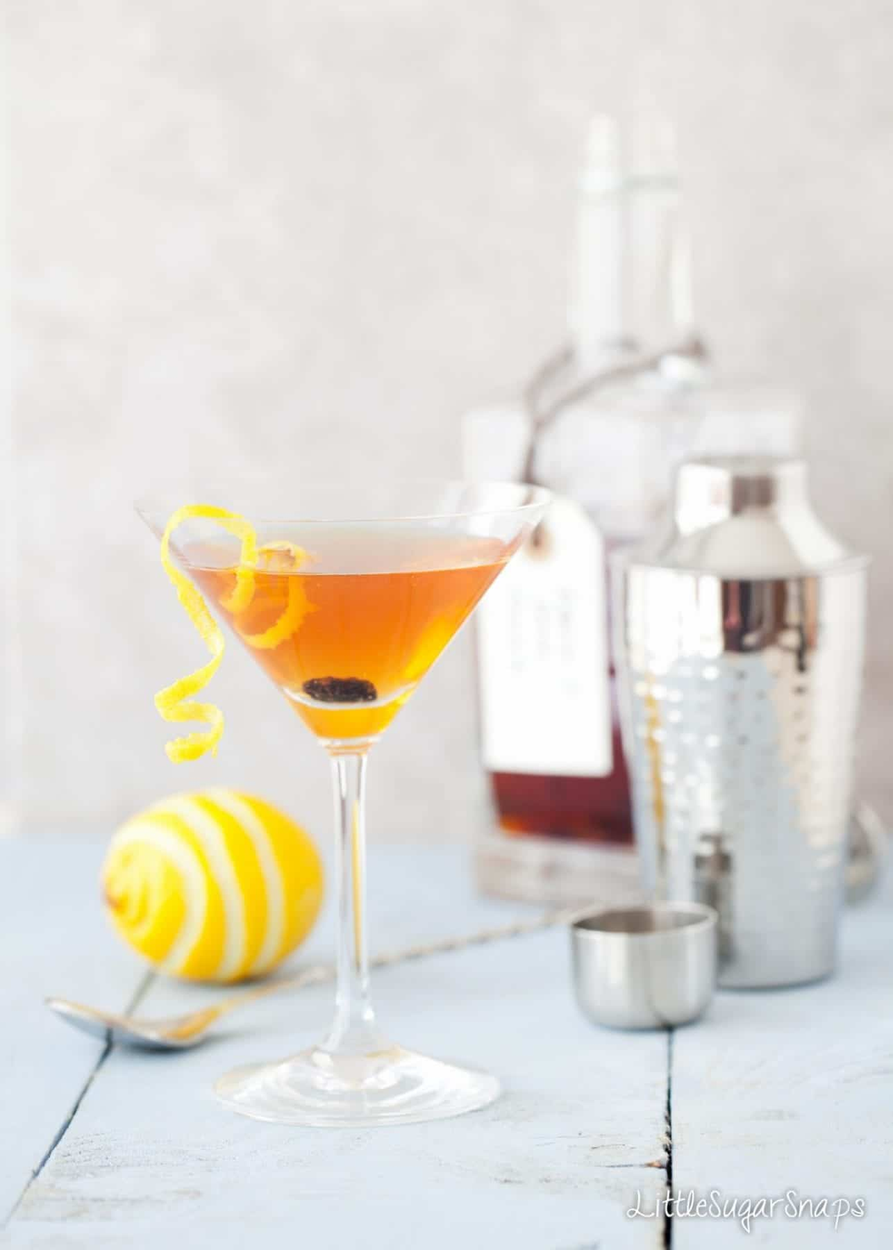 Hot Cross Bun Easter martini decorated with a lemon zest and raisins.