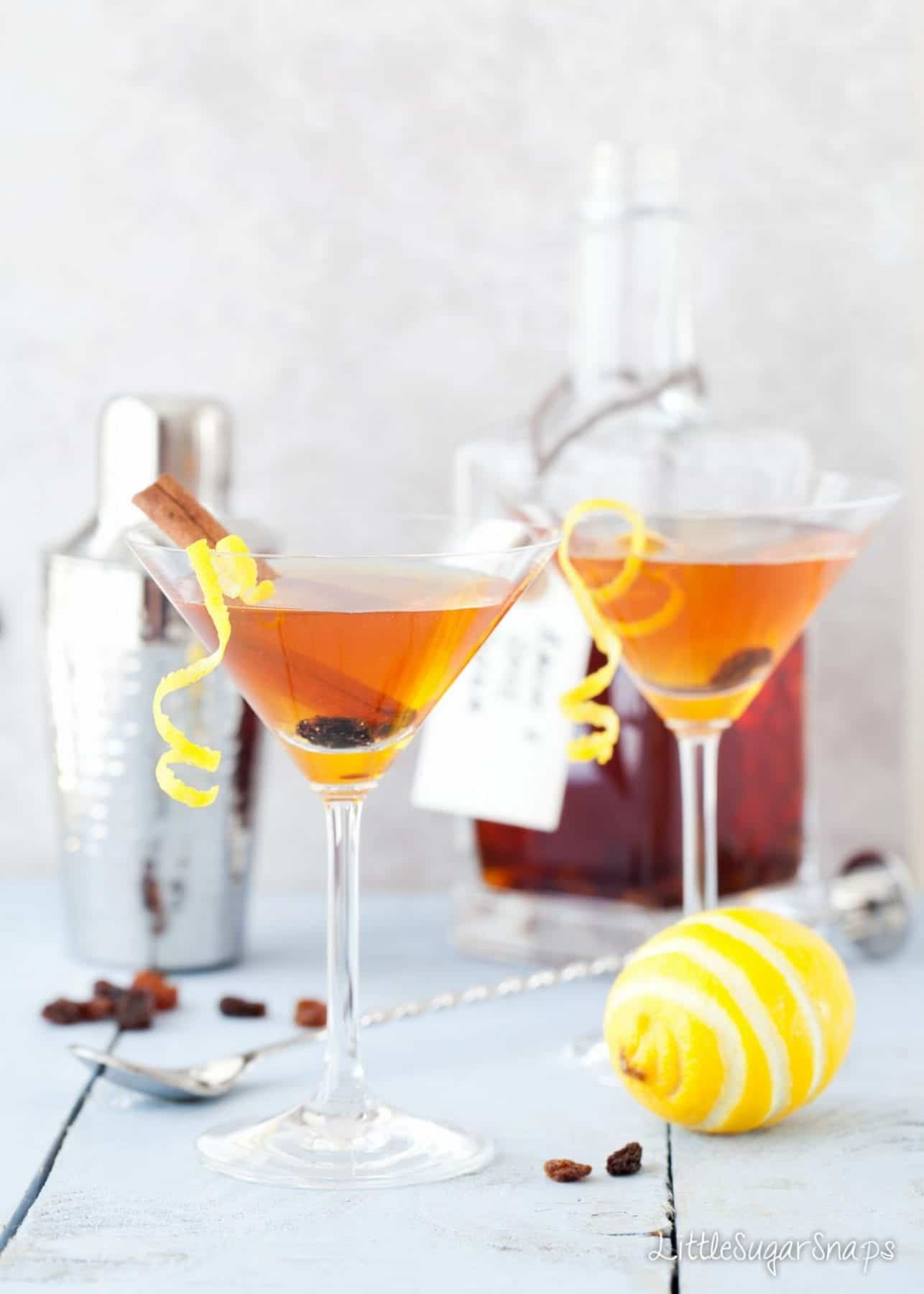 Hot cross bun flavoured Easter martini garnished with lemon, cinnamon and raisins.