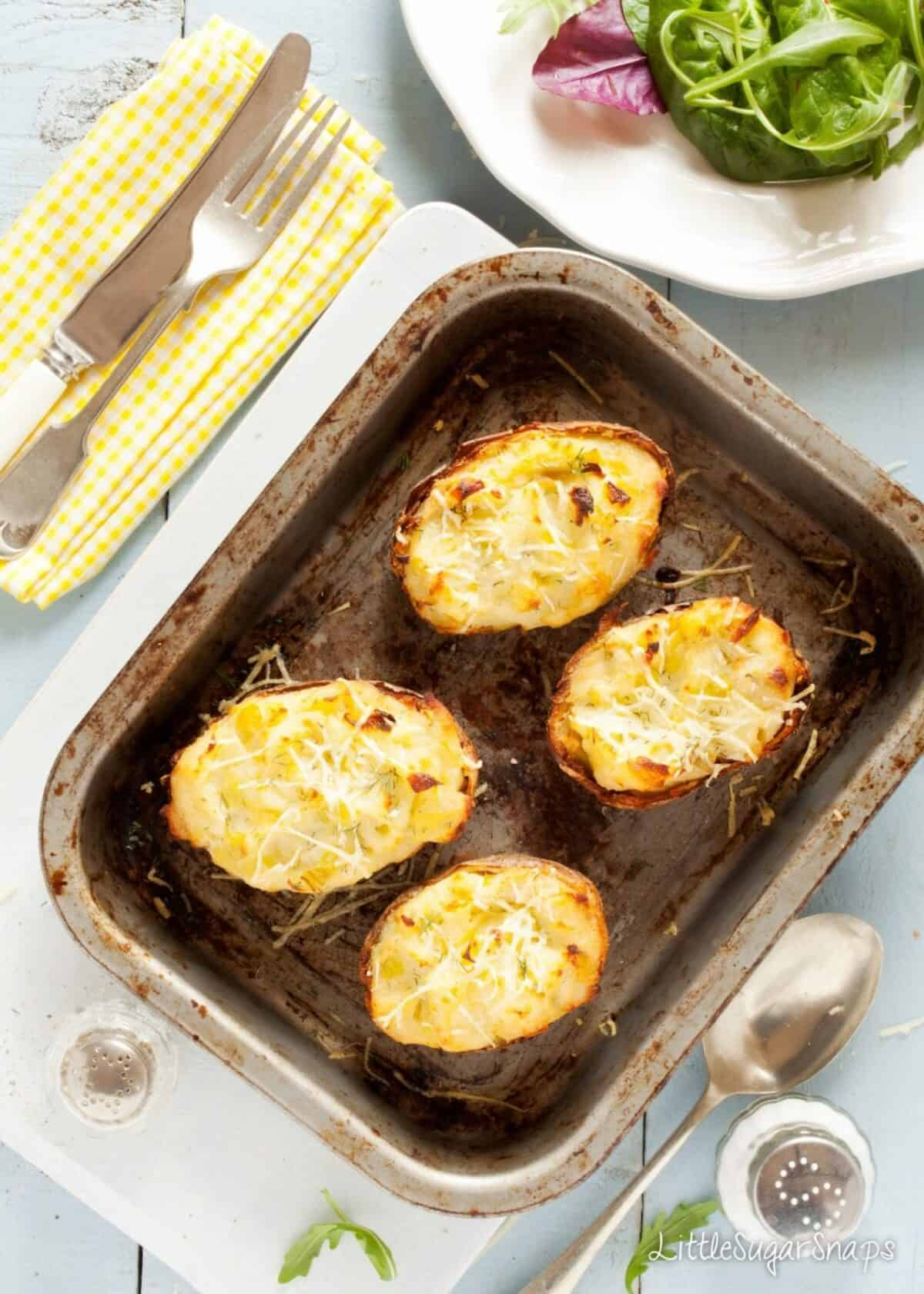 Four halves of Cheesy Leek Baked Potatoes just cooked.