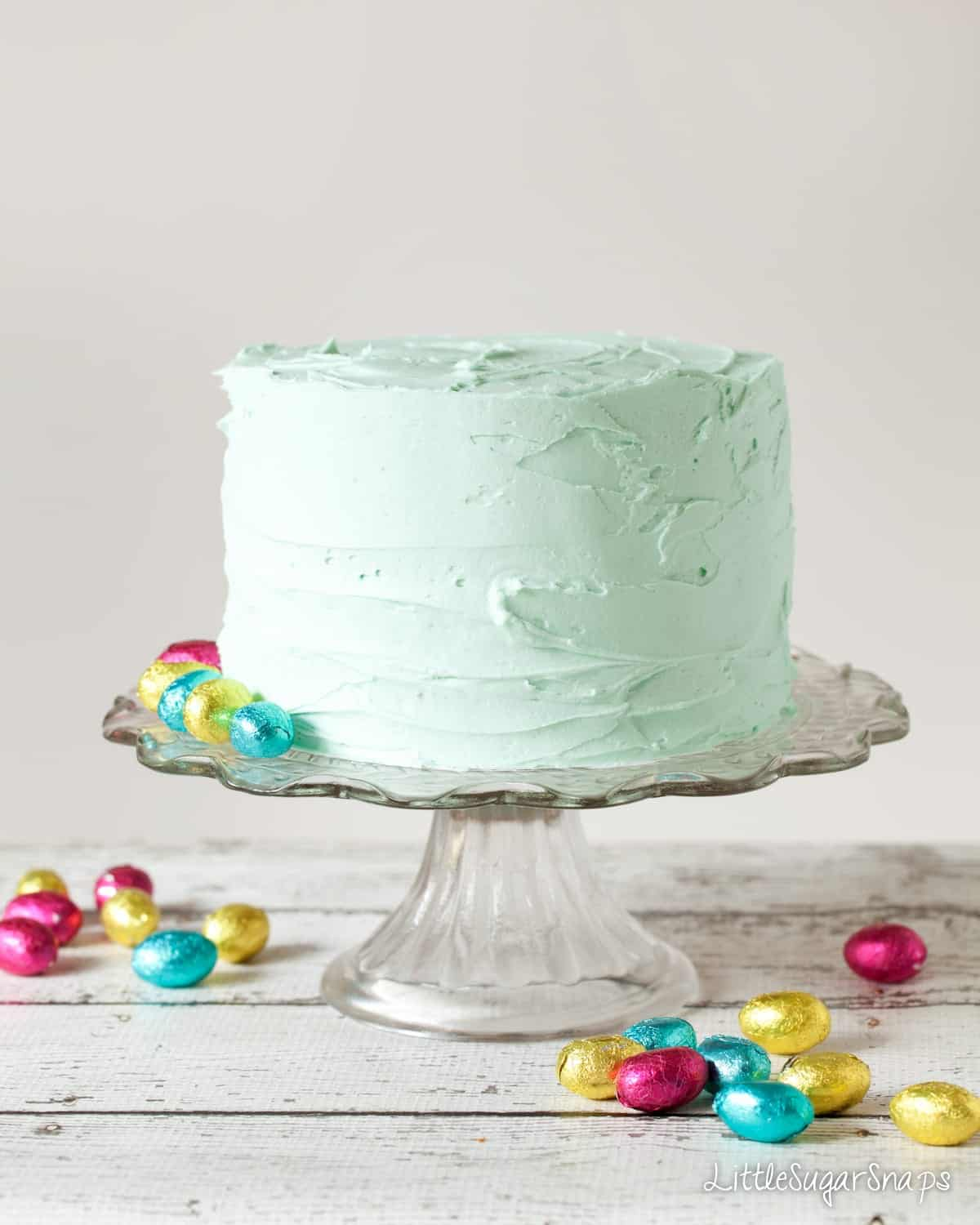 White chocolate easter cake recipe covered in pastel coloured peppermint buttercream