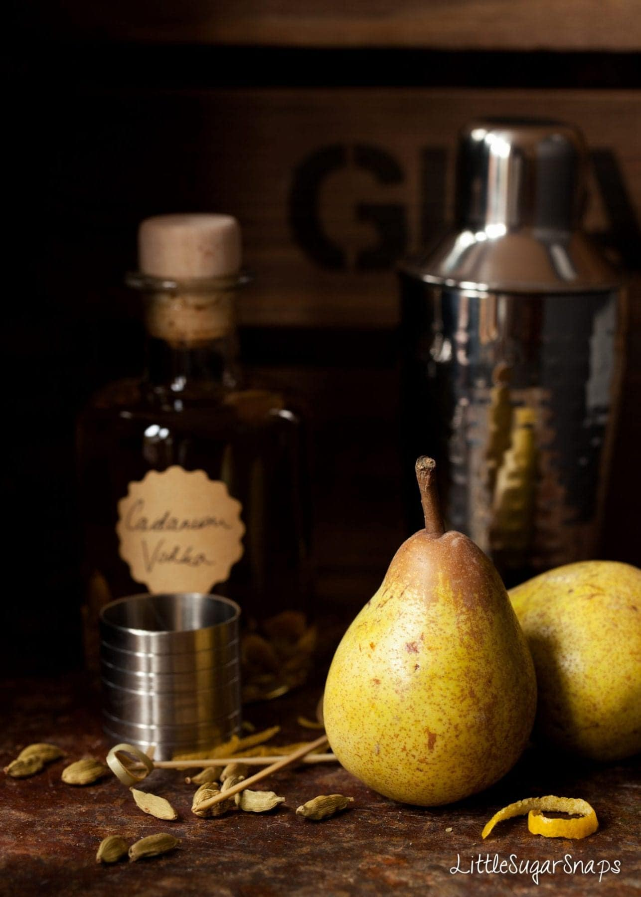 Fresh pears and a bottle of cardamom infused vodka