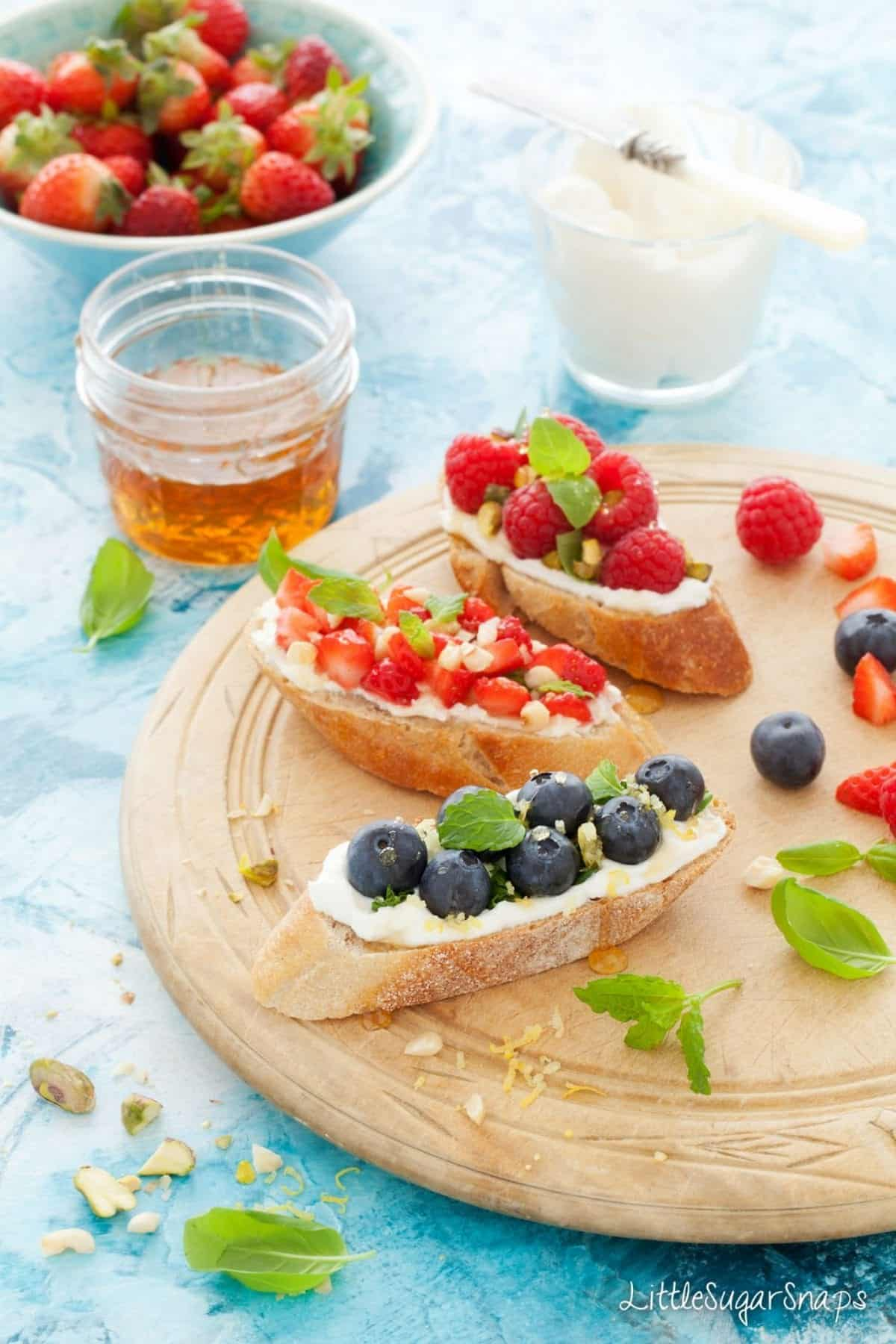 Mixed Berries on Toast with cream cheese and fresh fruit