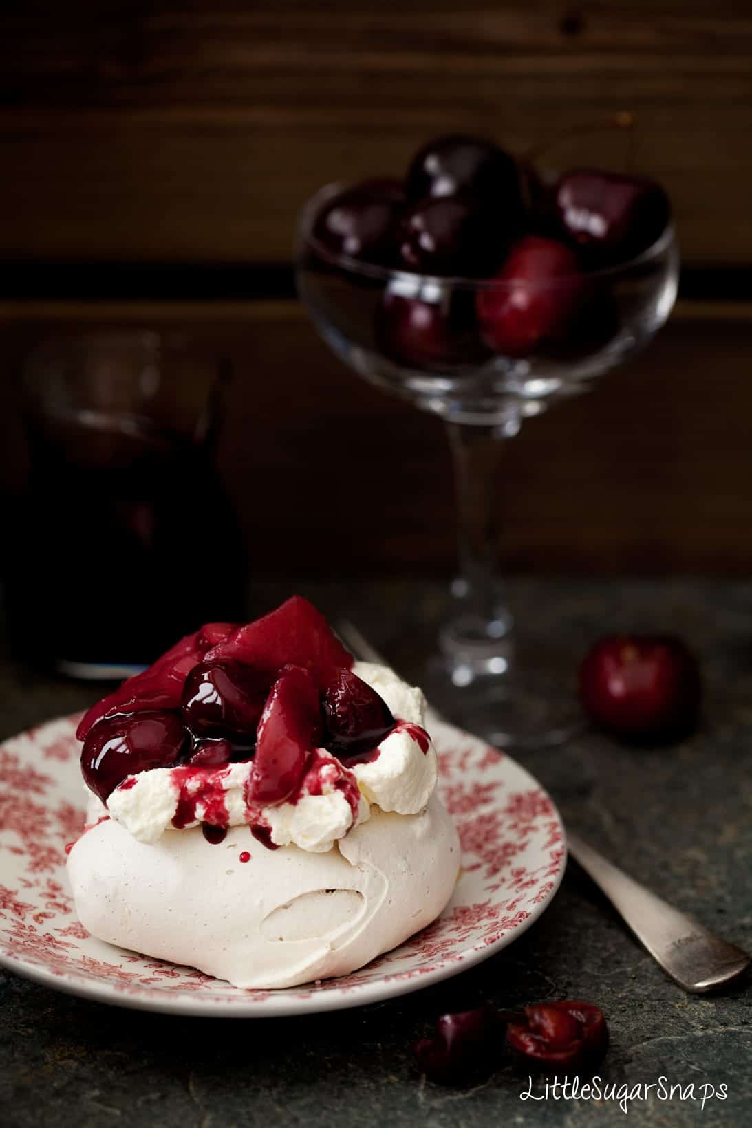 Muscovado Meringue with whipped cream and red wine poached fruit.