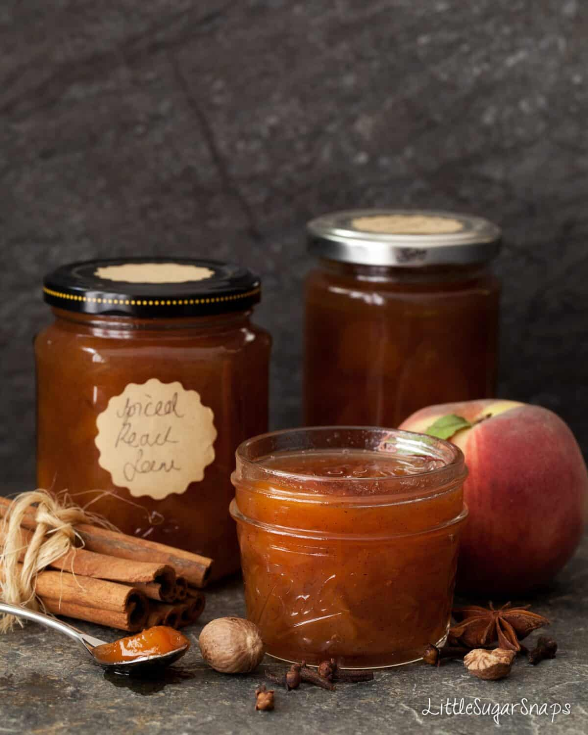 Spiced Peach Jam with ingredients alongside: peaches, cinnamon, anise, clove and nutmeg.