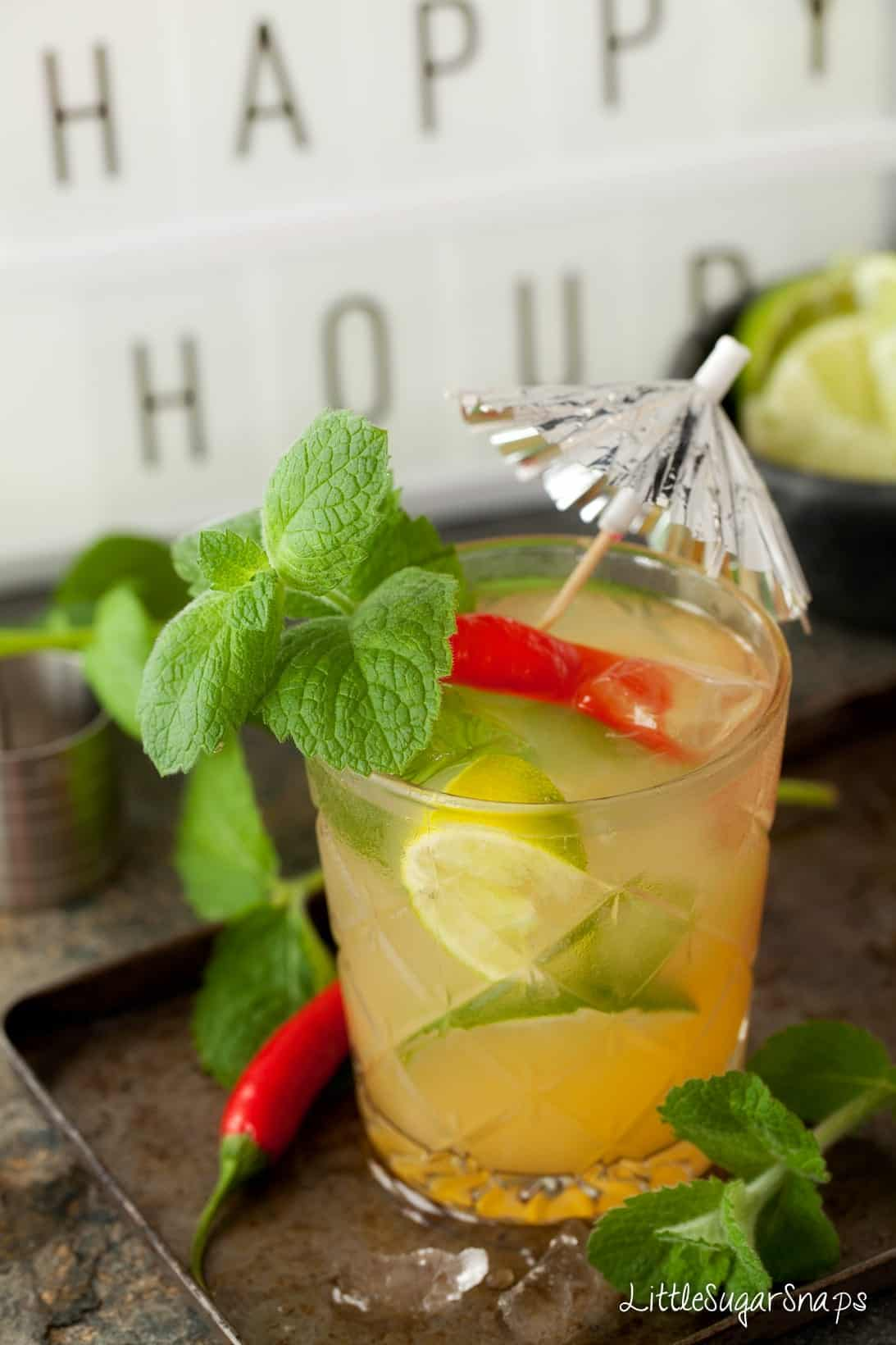 A cocktail made with chilli vodka decorated with red chilli, lime and lime.
