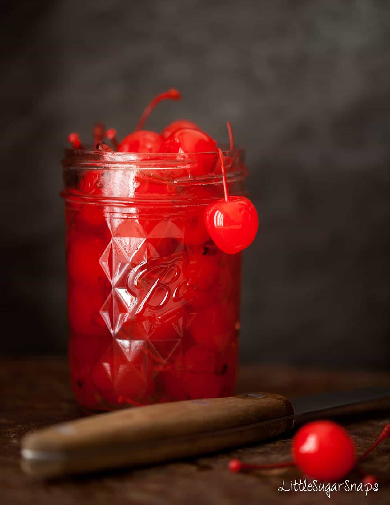 A jar of maraschino cocktail cherries.