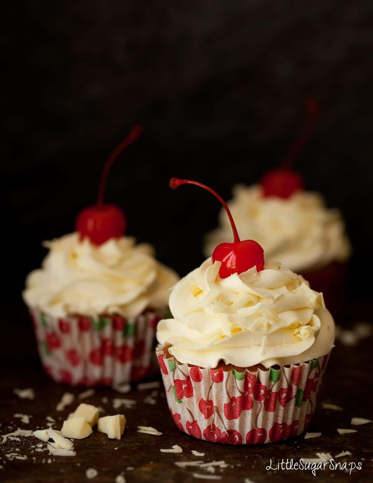 Cherry Cupcakes with buttercream and white chocolate flakes.