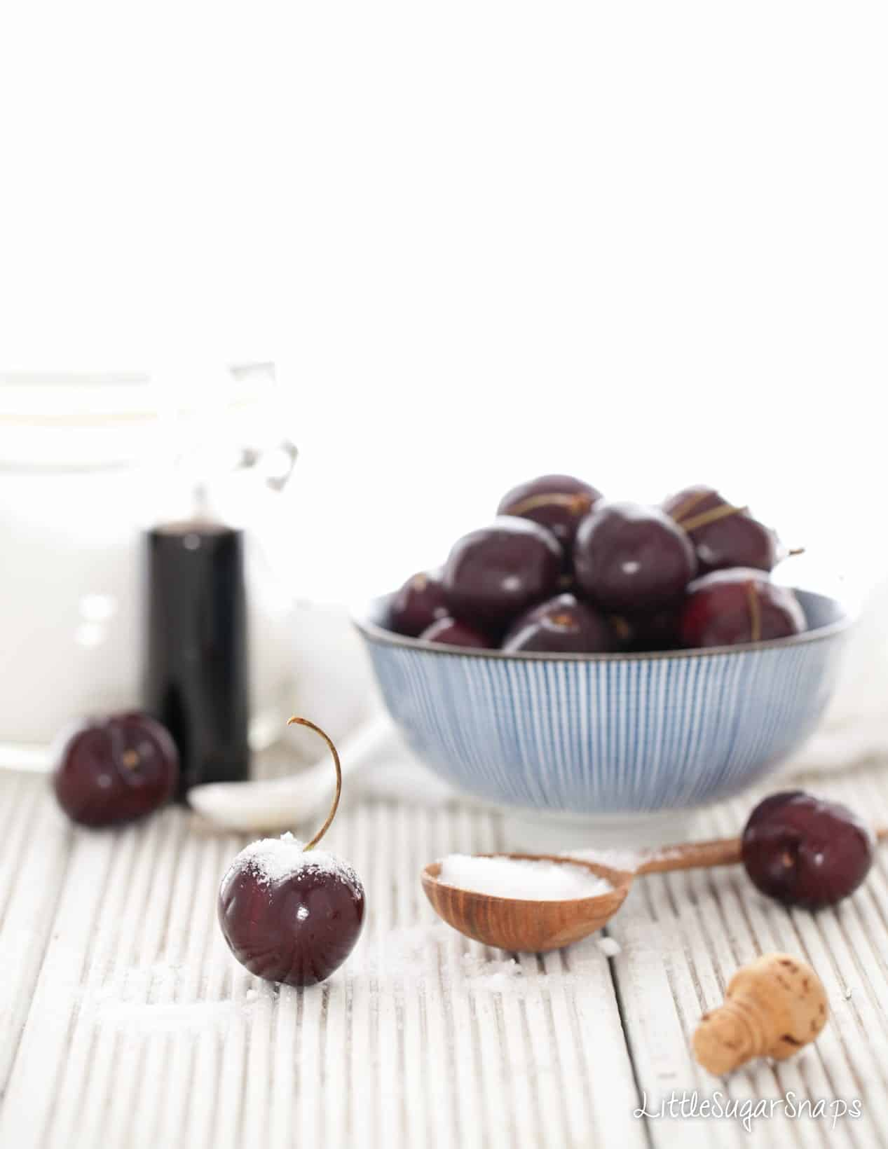 Fresh cherries in a blue bowl