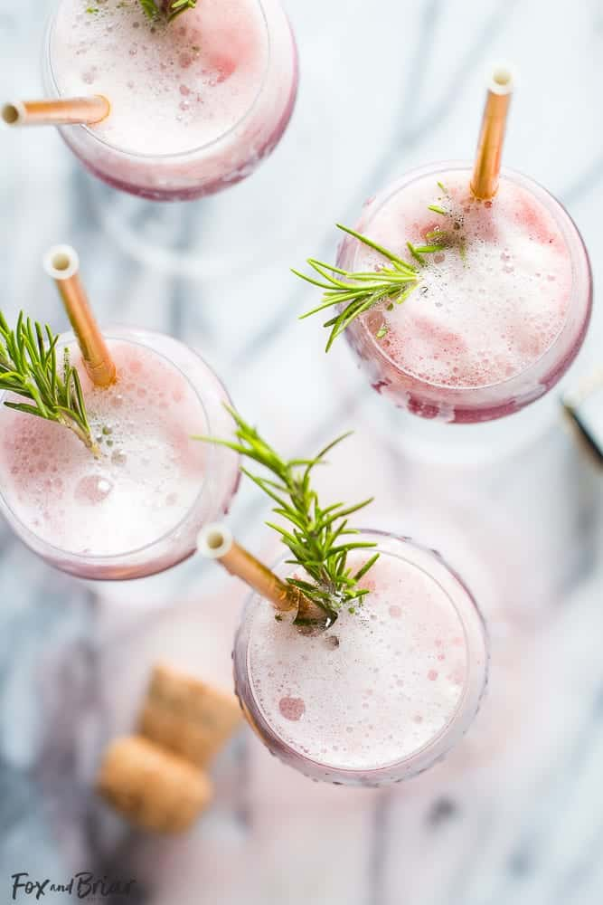 Overhead view of raspberry sorbet mimosa with rosemary