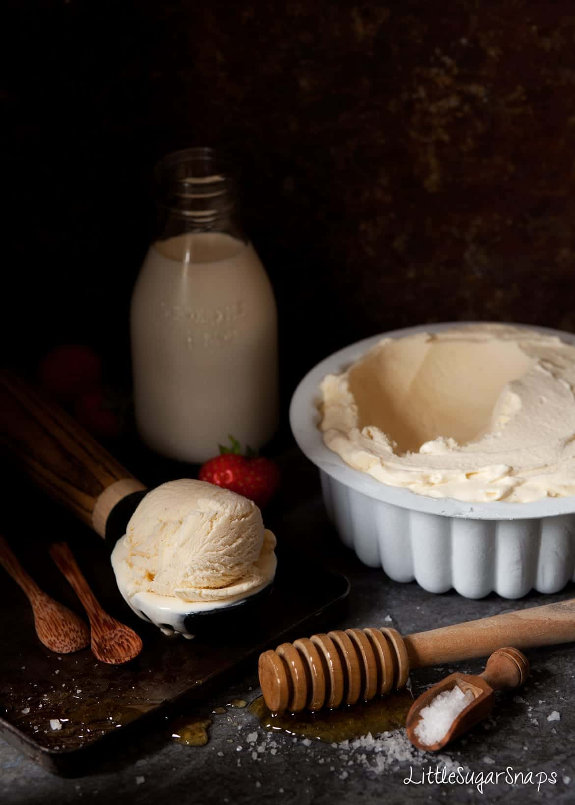 A tub of Salted Honey Ice Cream with ingredients alongside