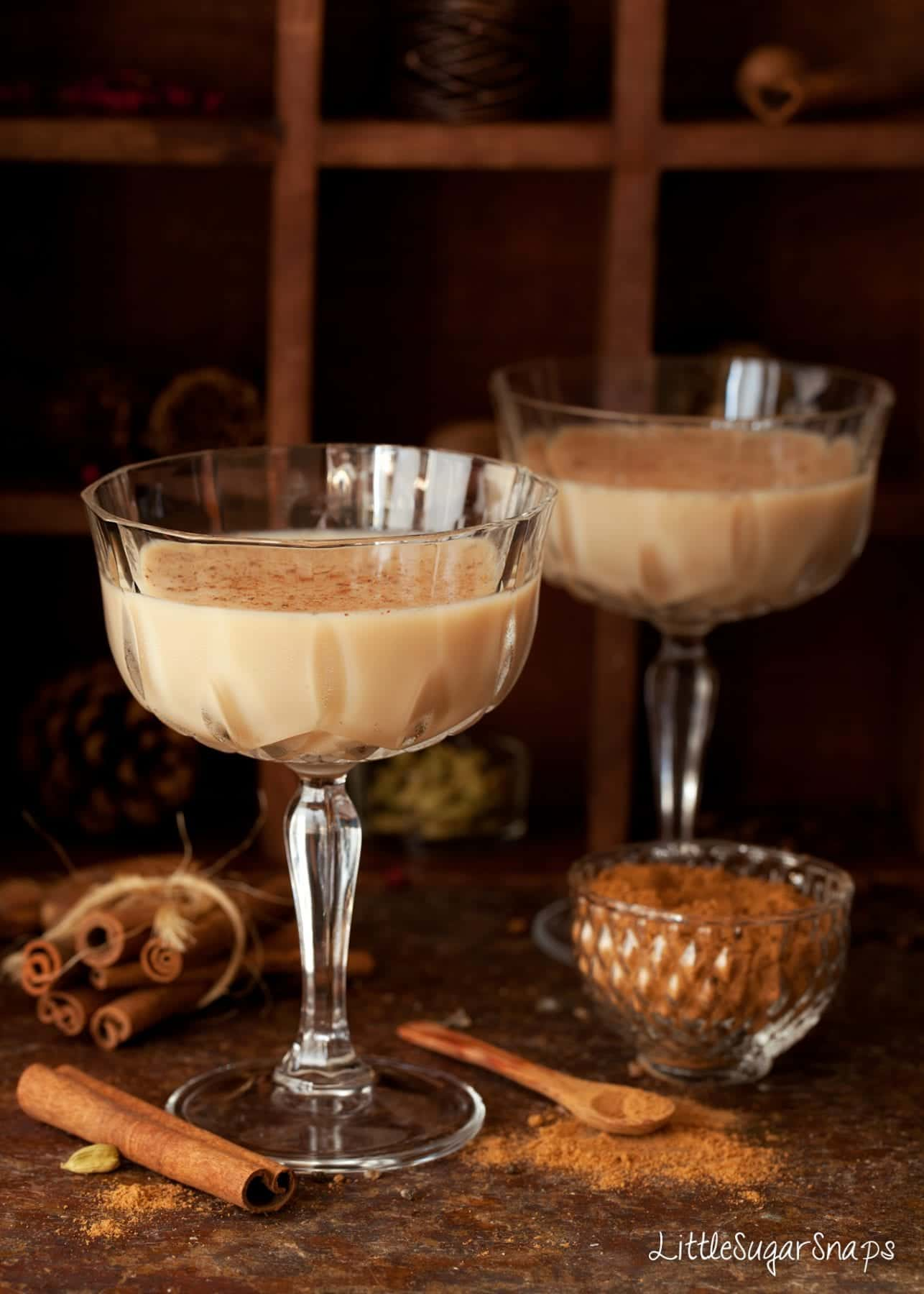 Glasses of Spiced Chai Latte Martini topped with ground spice