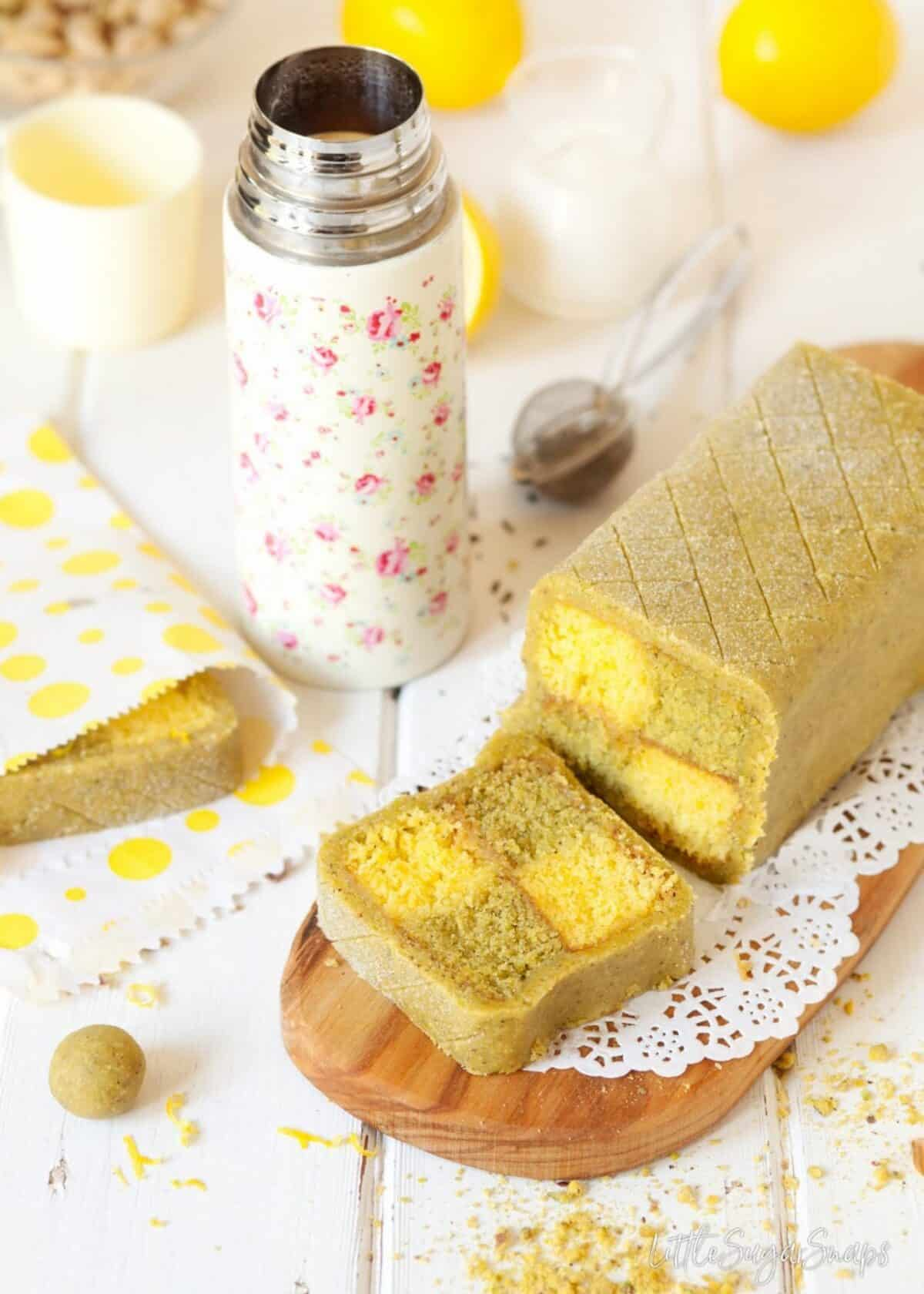 Pistachio and Lemon Battenberg Cake with a slice cut from it.